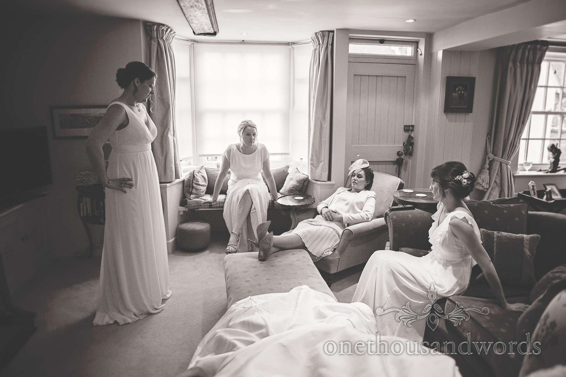 Black and white wedding photograph of bridesmaids awaing bride on wedding morning