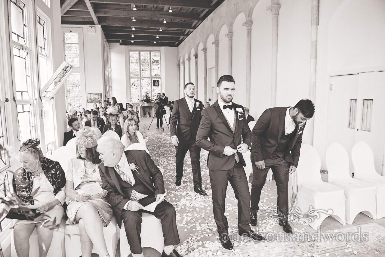 Black and White wedding photograph of groom at Highcliffe Castle Wedding