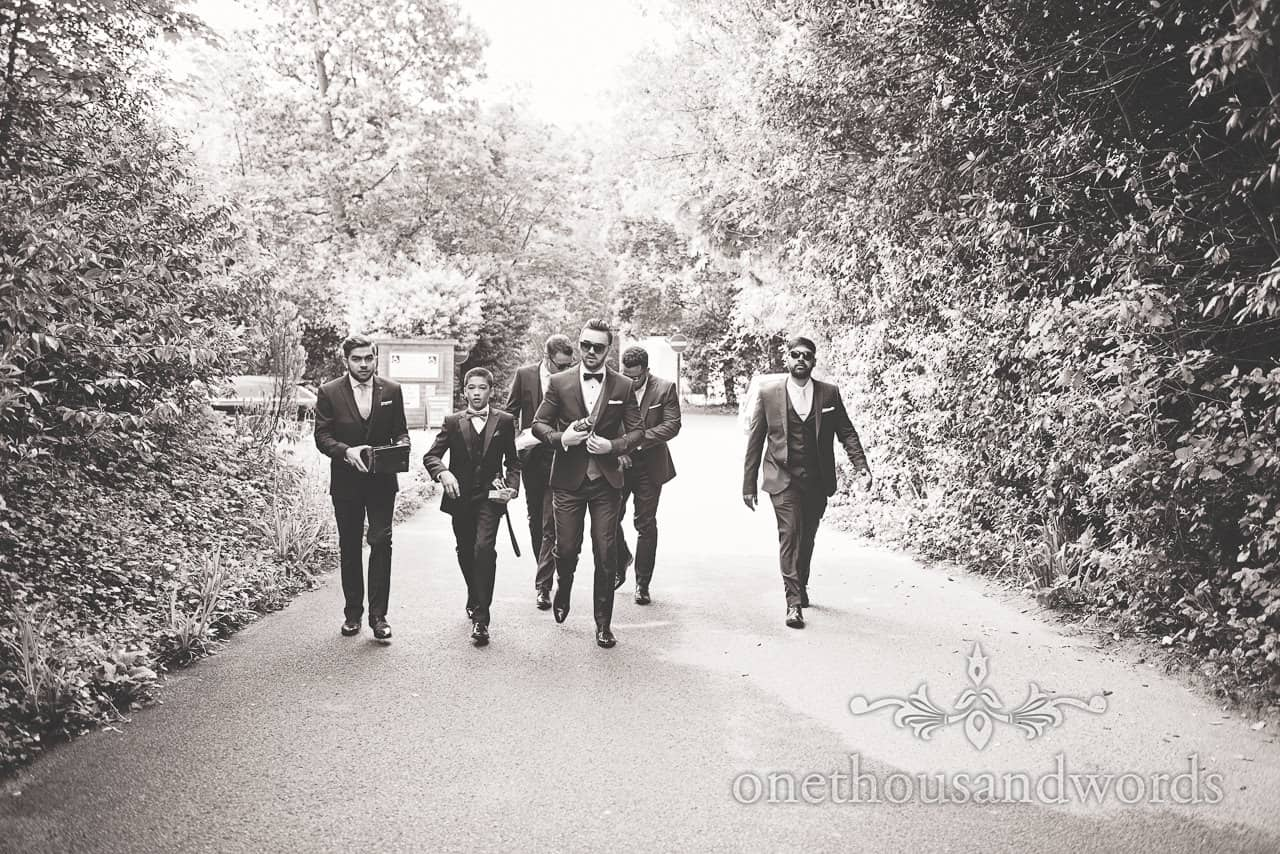 Black and White wedding photograph of groomsmen in bow ties arriving at Hghcliffe Castle wedding venue