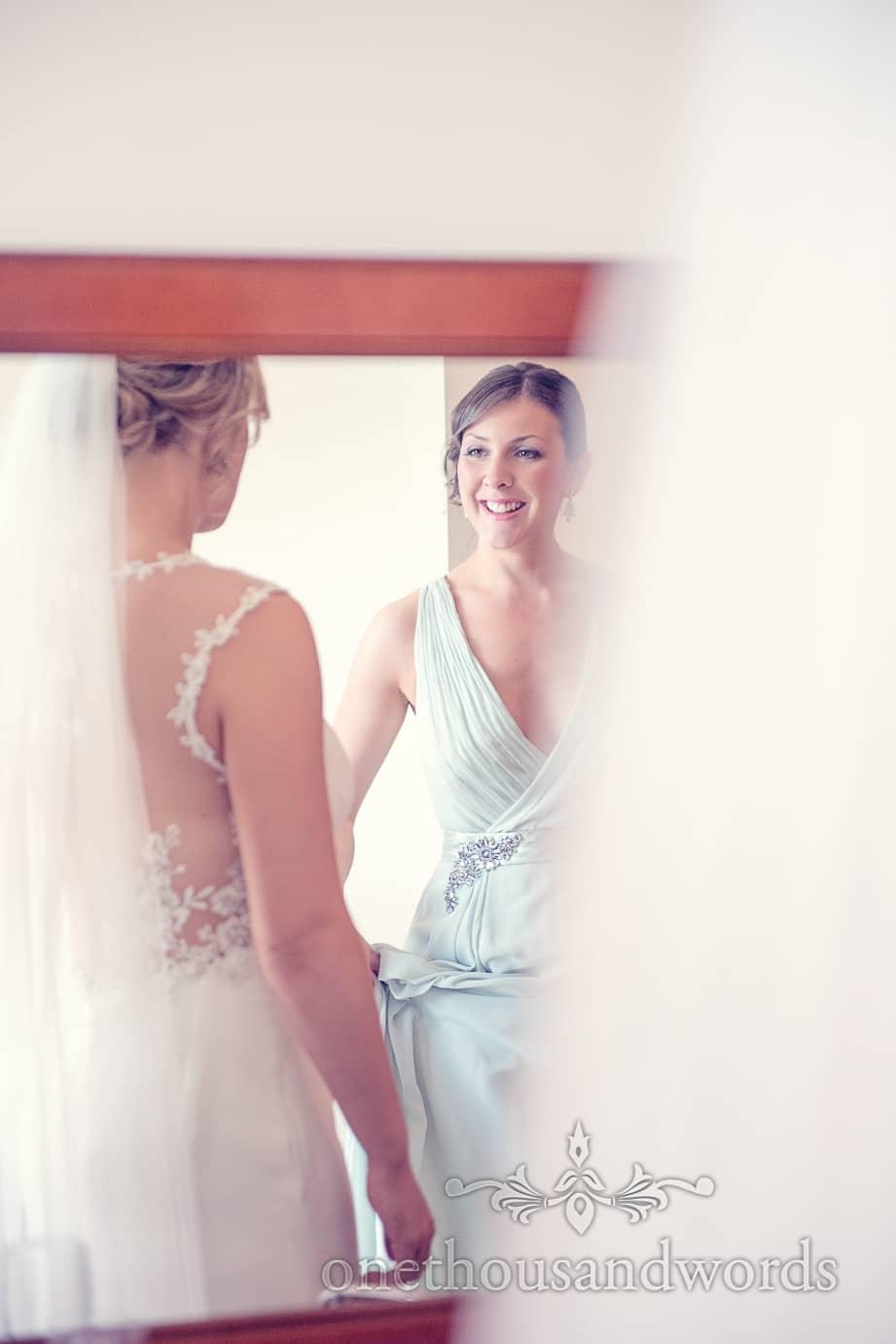 Bride and bridesmaid in mirror from Italian Villa Wedding Photographs