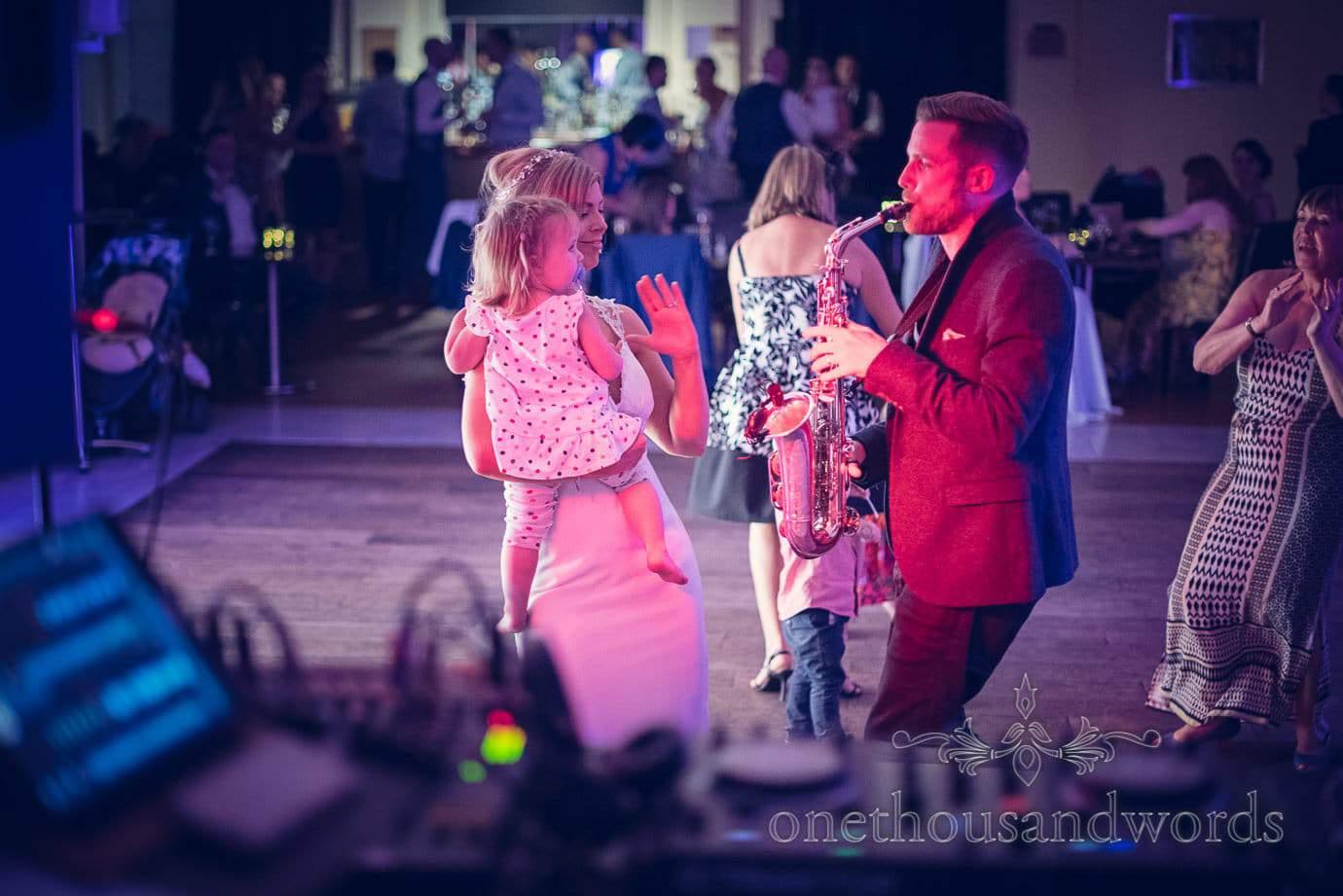 Bride and child on dance floor at Italian Villa Wedding Photographs