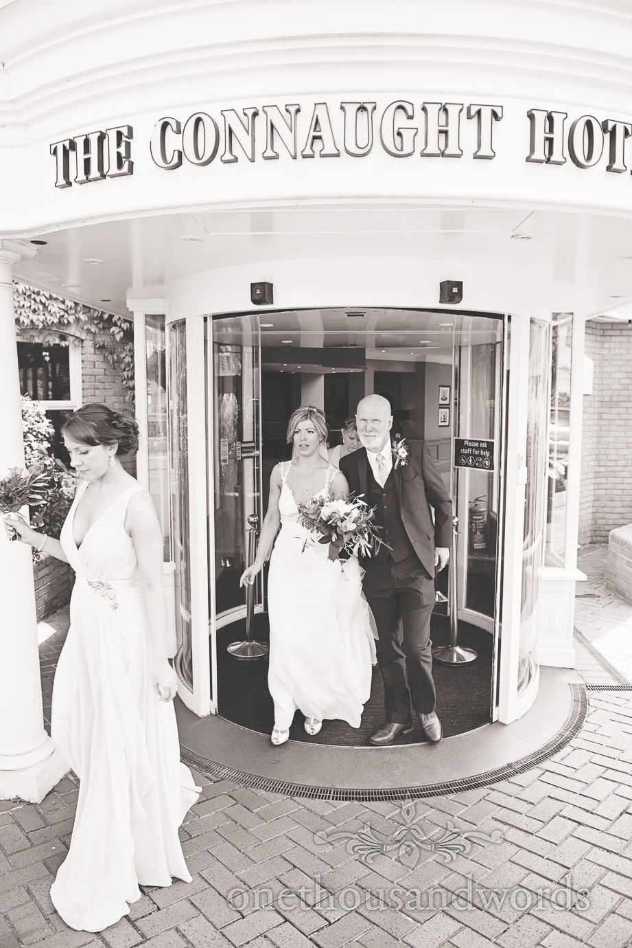 Bride and father leave hotel for Italian Villa Wedding Photographs