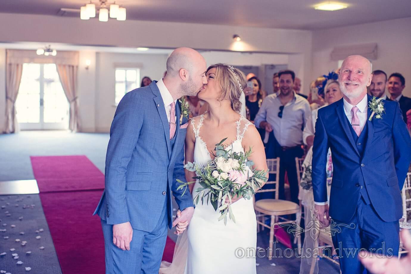 Bride and groom kiss during ceremony at Italian Villa Wedding Photographs