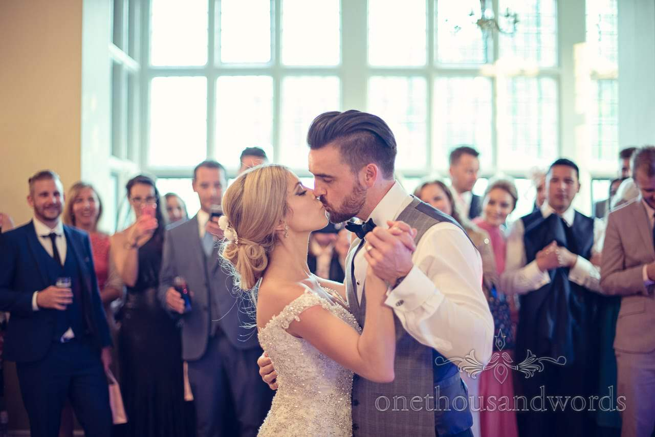 Bride and Groom kiss during first dance at Rhinefield House Wedding
