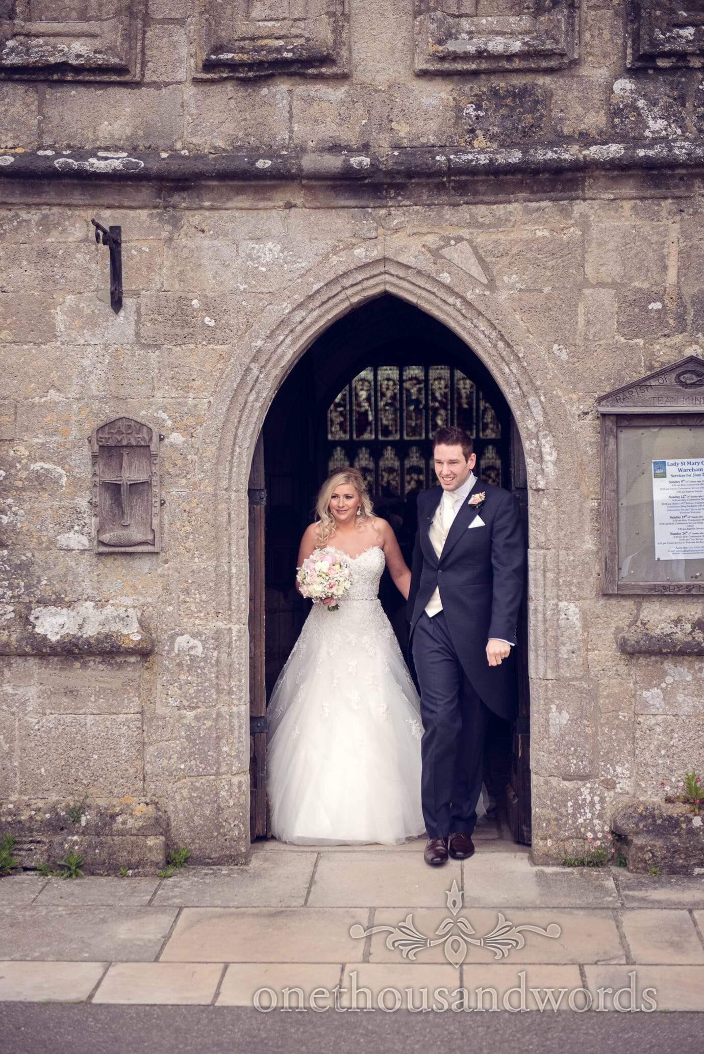 Bride and groom leave St Marys Church wedding in Wareham, Dorset