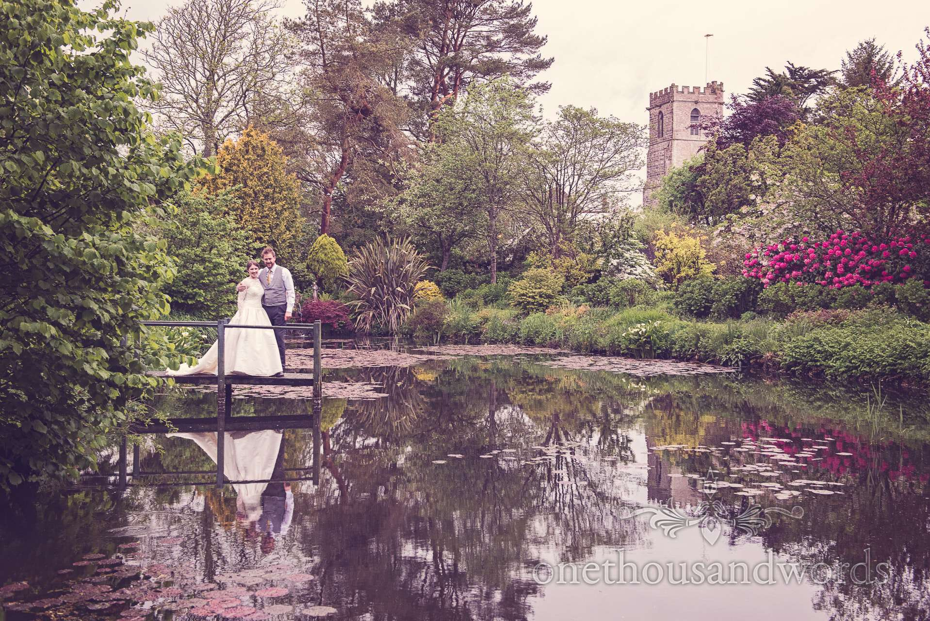 Bride and Groom next to lake at The Priory Wareham wedding