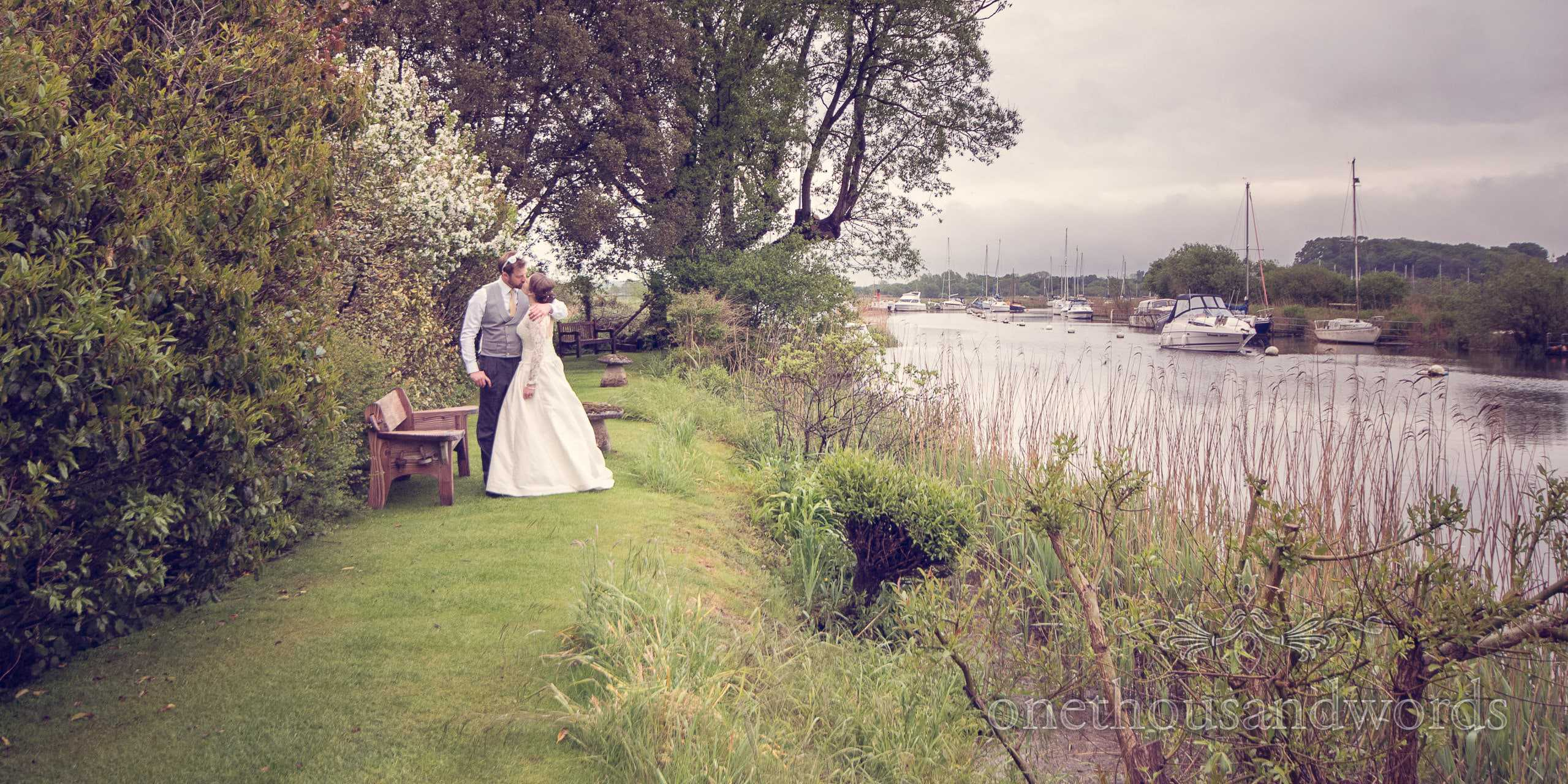Bride and Groom next to Wareham River at The Priory Wareham wedding