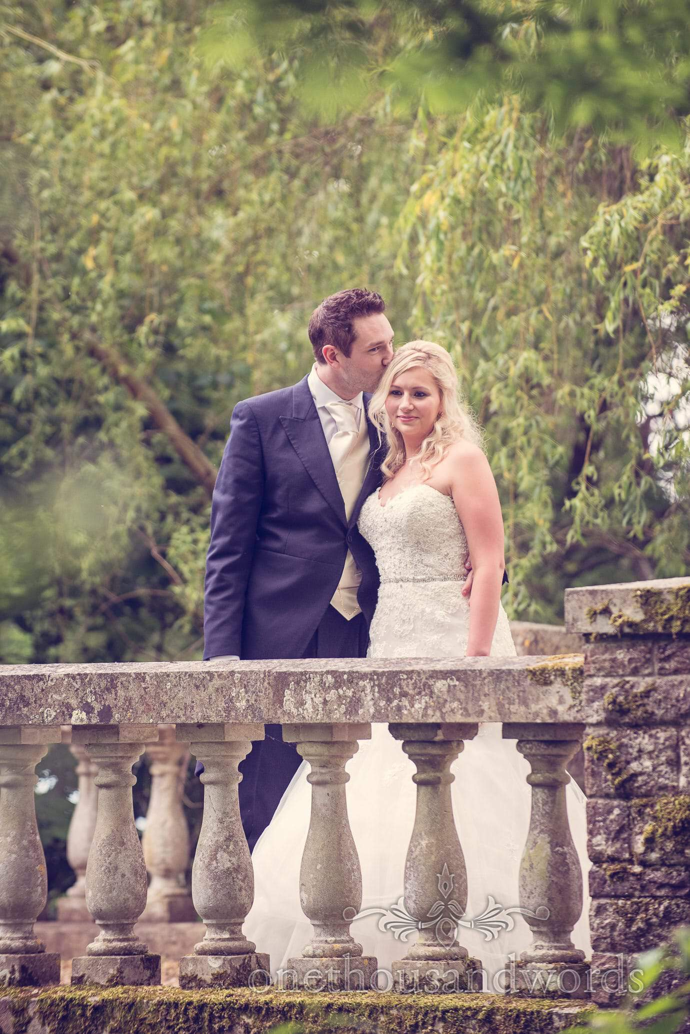 Bride and groom on Stone Bridge at Deans Court Wedding