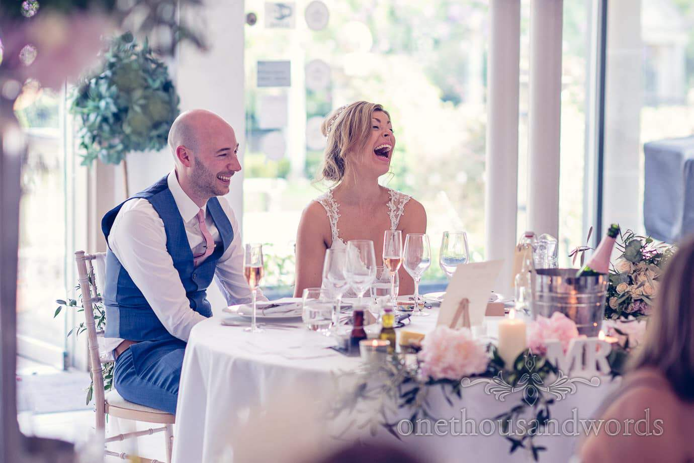 Bride and groom reaction during speeches at Italian Villa Wedding Photographs