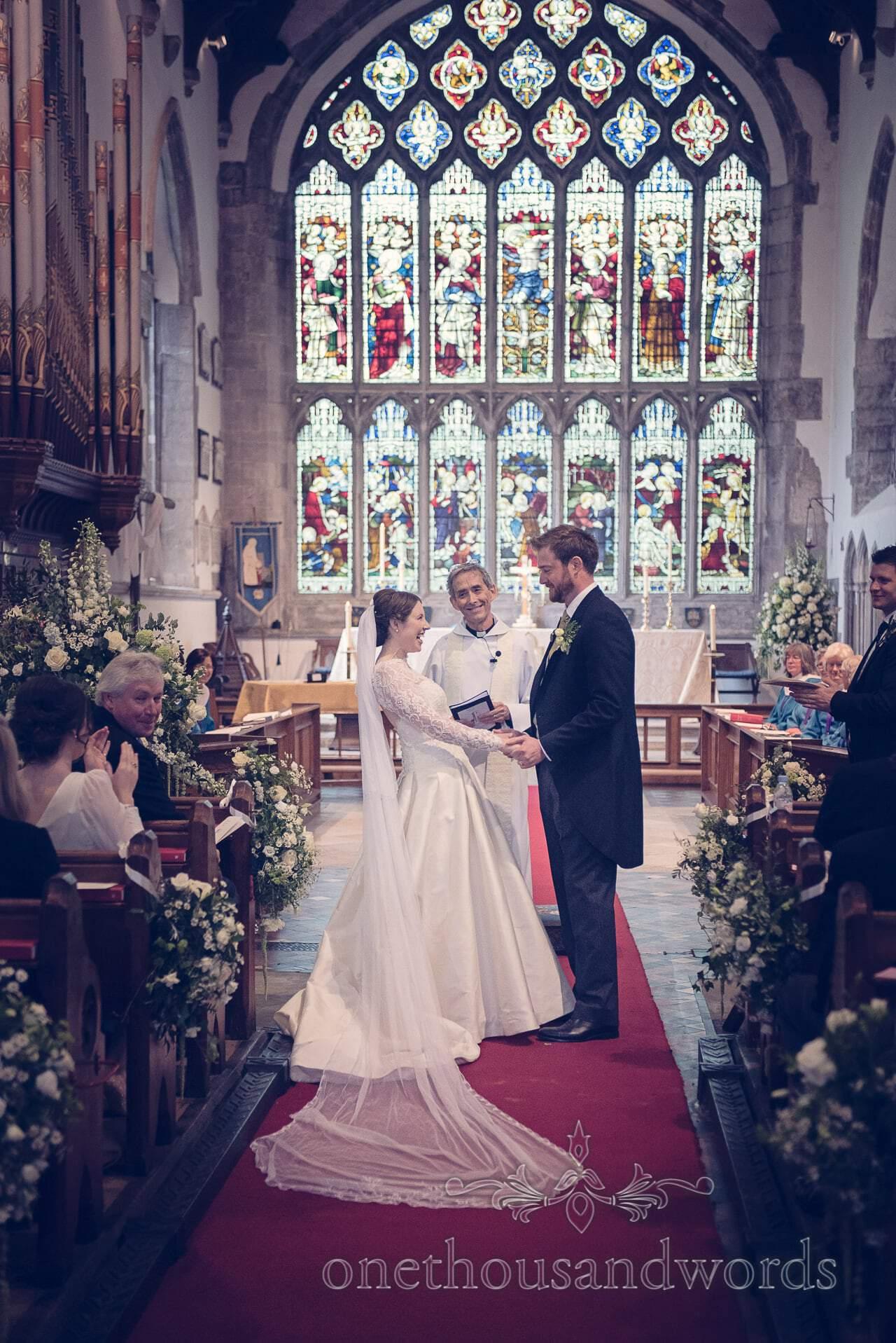 Bride and groom wedding service in St Marys Church, Wareham