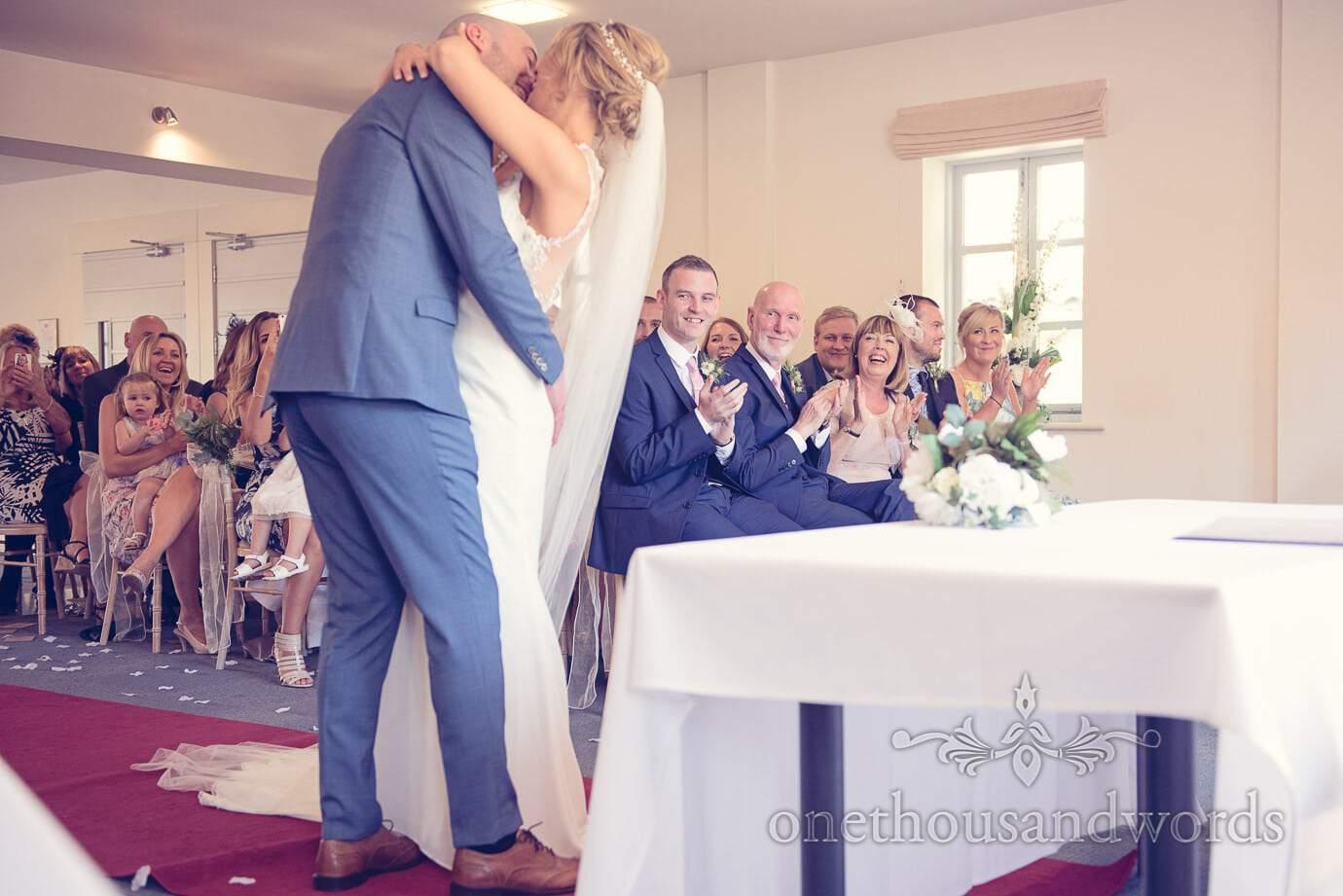 Bride and grooms first kiss at Italian Villa Wedding Photographs