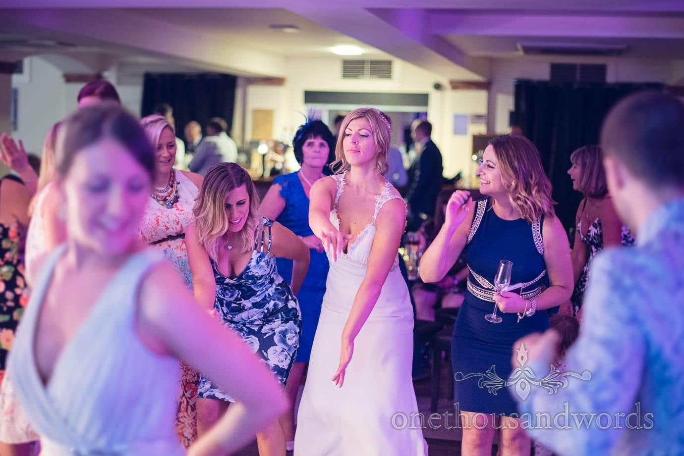 Bride and guests dance at Italian Villa Wedding Photographs