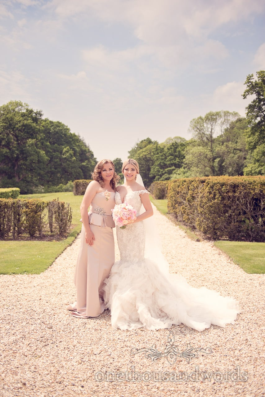 Bride and mother in garden at Rhinefield House Wedding