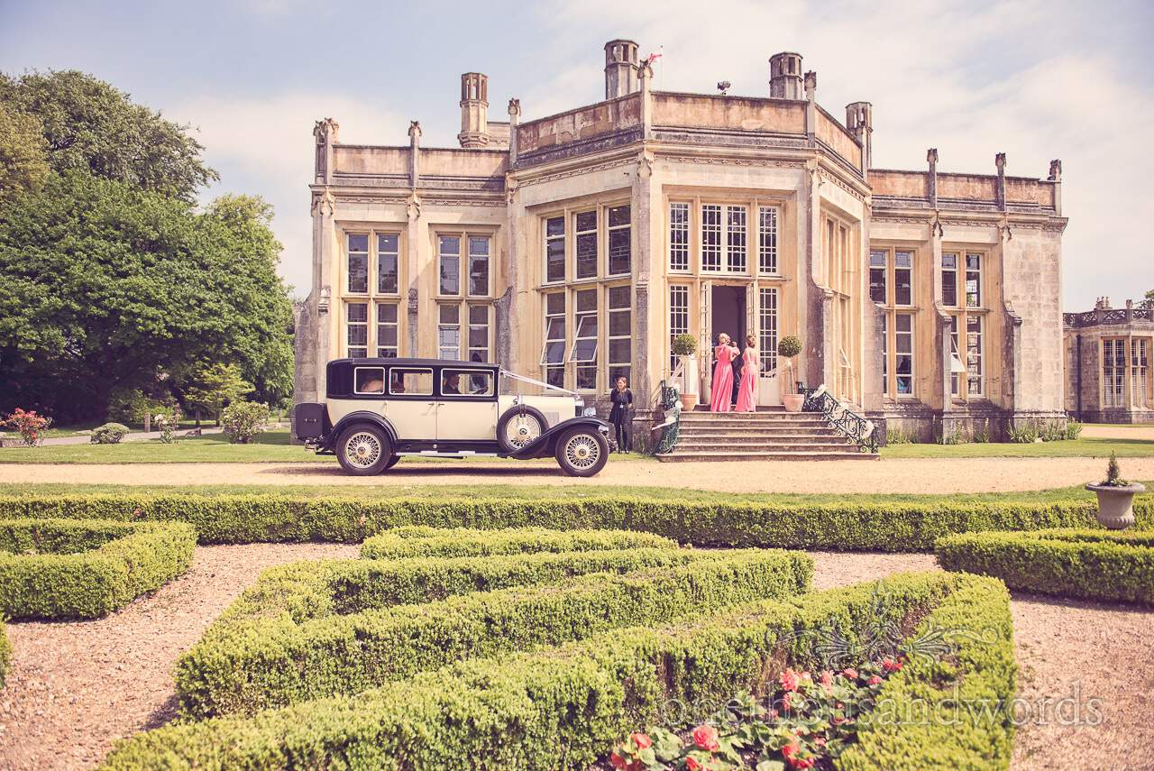 Bride arrives in wedding car at Highcliffe Castle