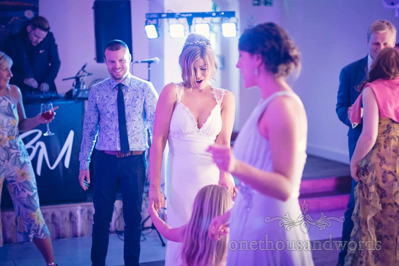 Bride dances with child at Italian Villa Wedding Photographs