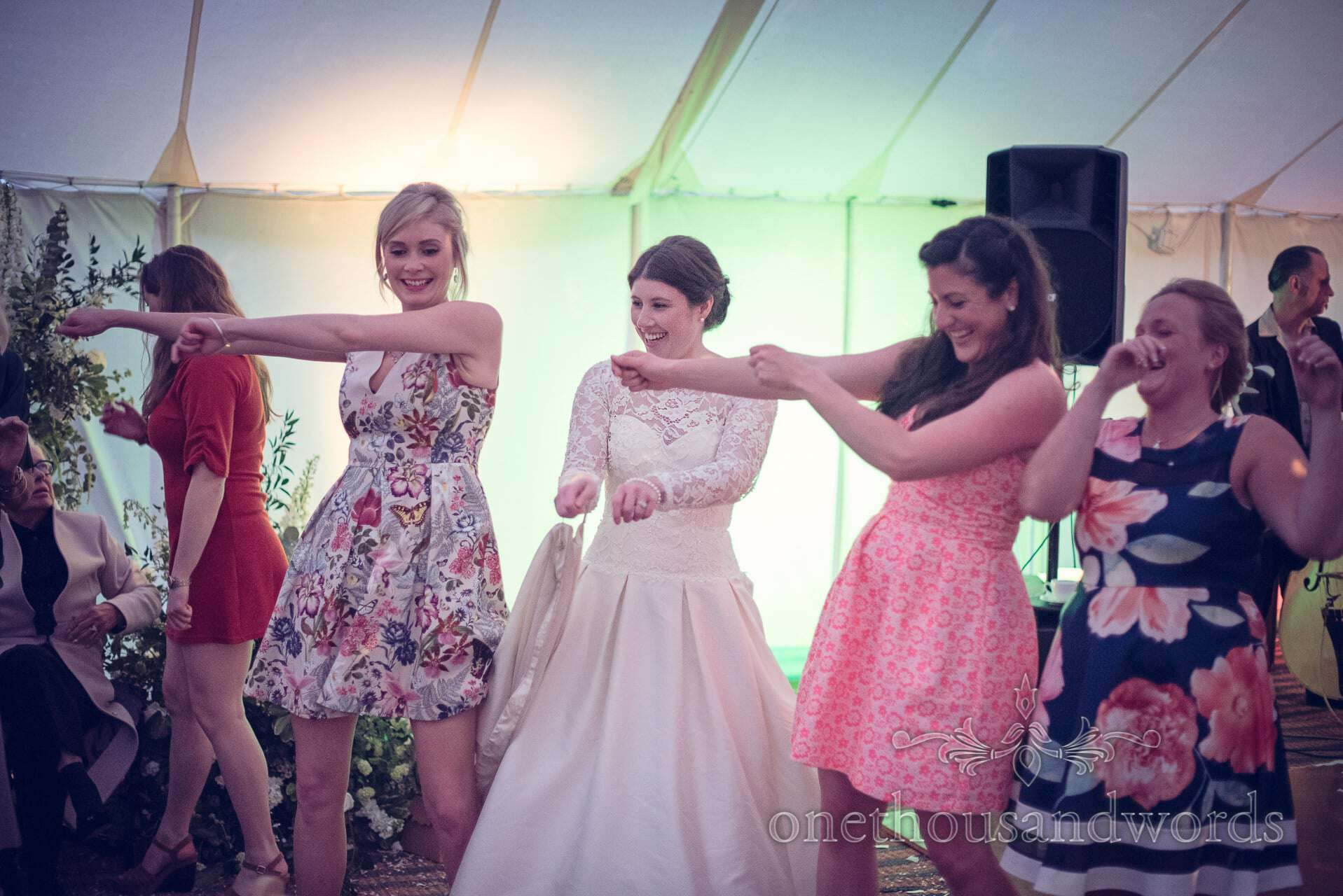 Bride dancing with her friends in evening at The Priory Wareham wedding