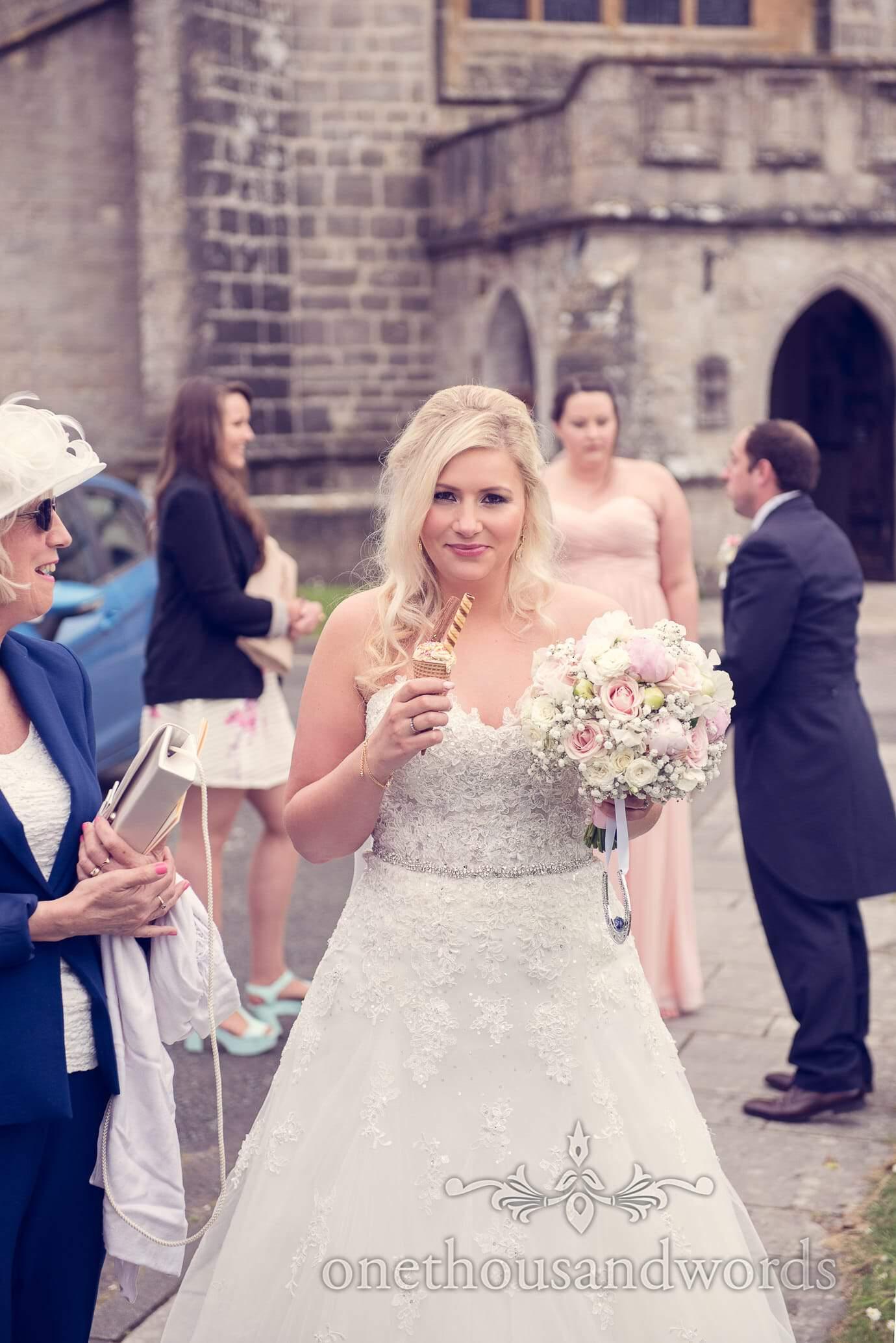 Bride eats ice cream outside church in Wareham