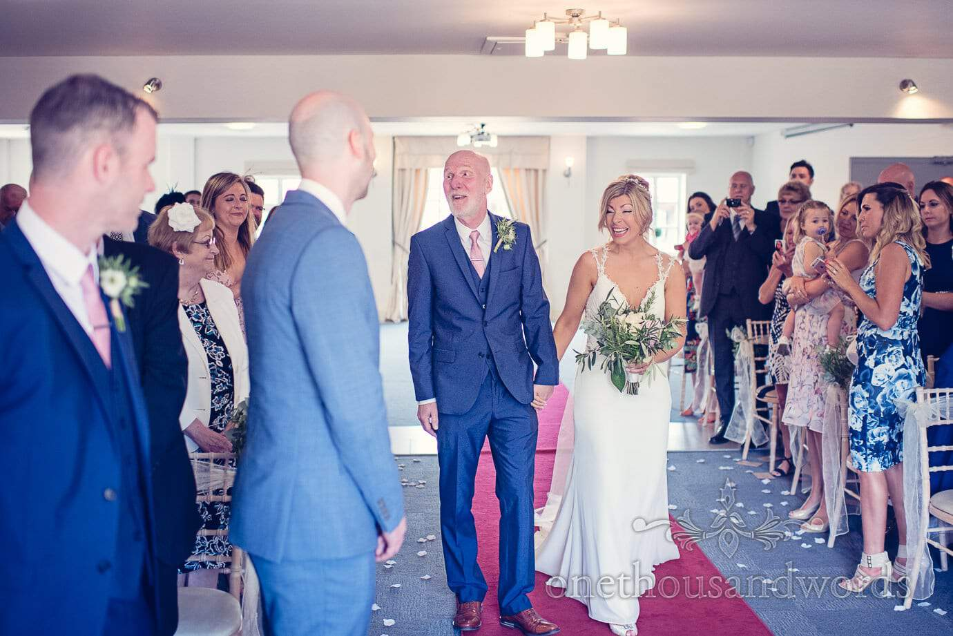 Bride escorted down the aisle by father at Italian Villa Wedding Photographs