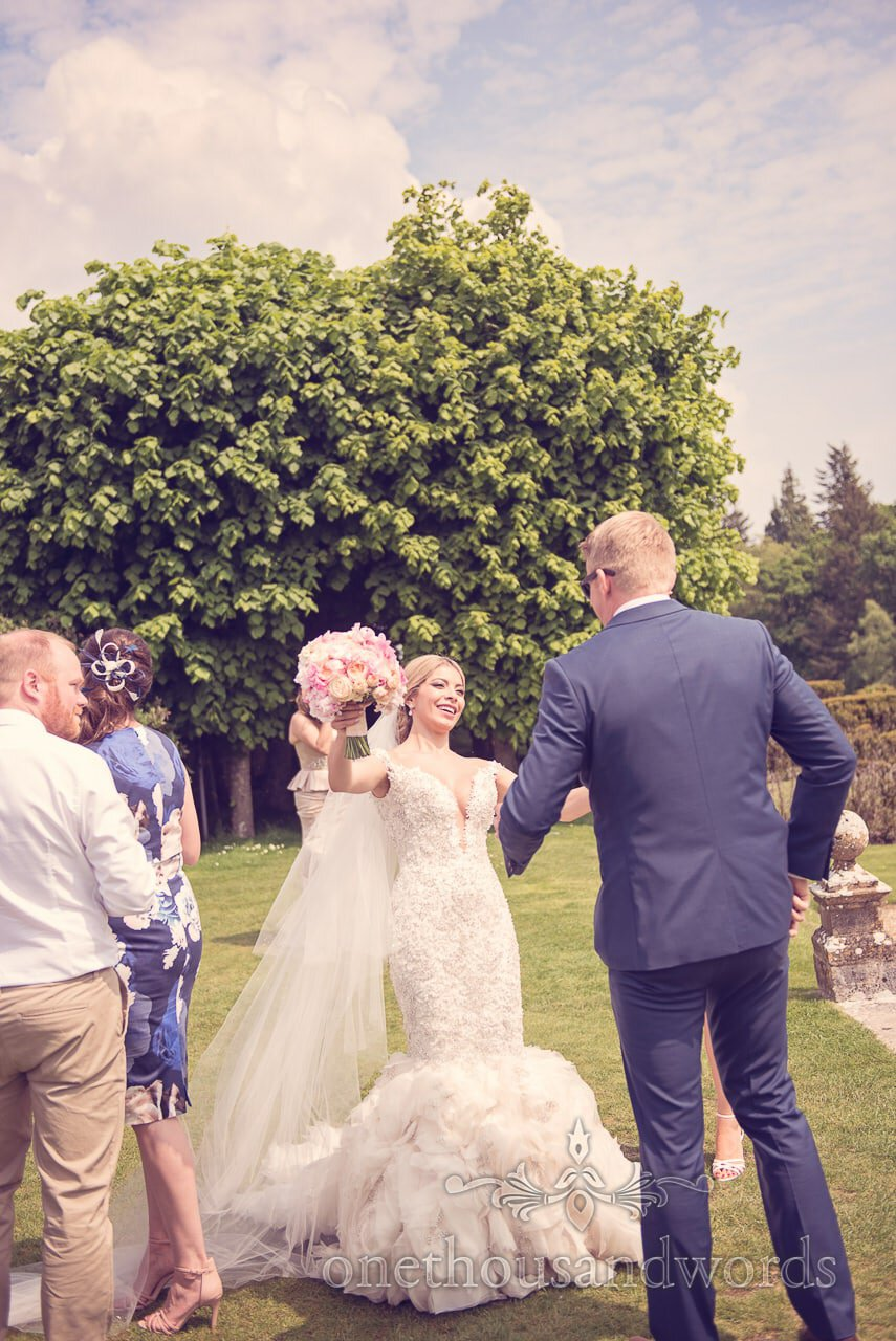 Bride greets guest at Rhinefield House Wedding