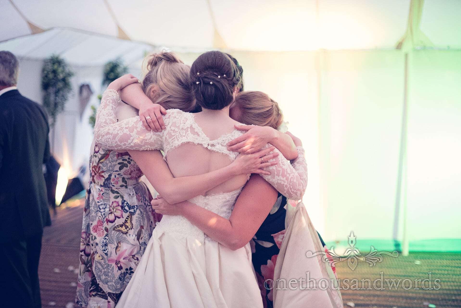 Bride hugs her friends at The Priory Wareham wedding