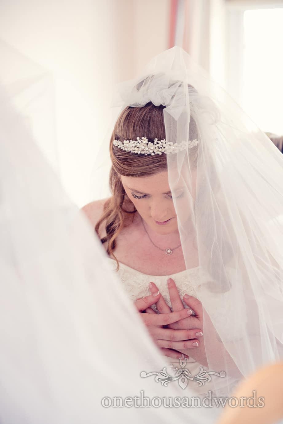 Bride in wedding tiara and veil portrait photograph on wedding morning