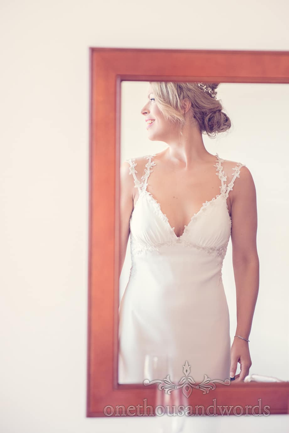 Bride in white wedding dress in mirror from our best wedding photos