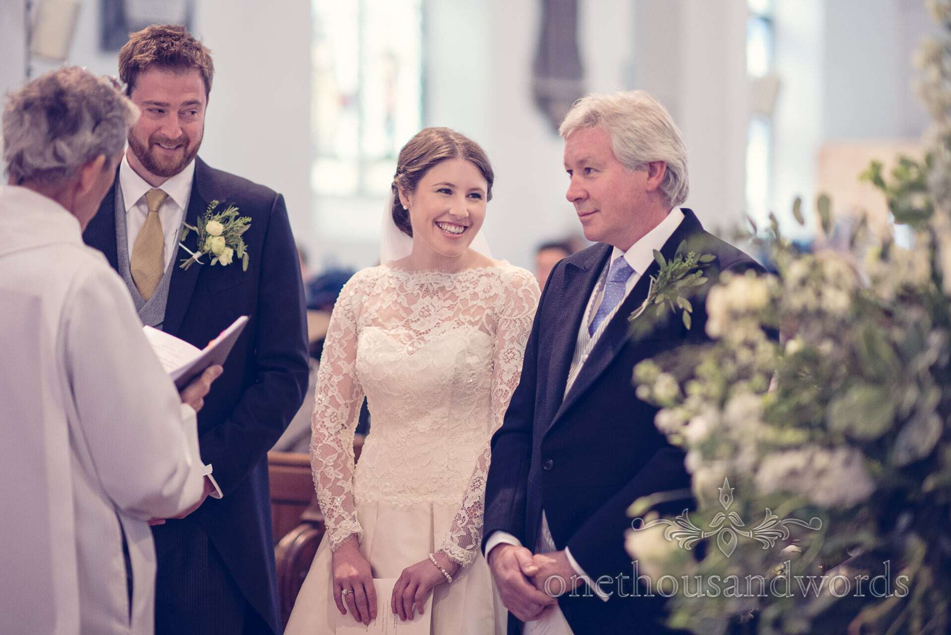 Bride is 'given away' by her father during church wedding service