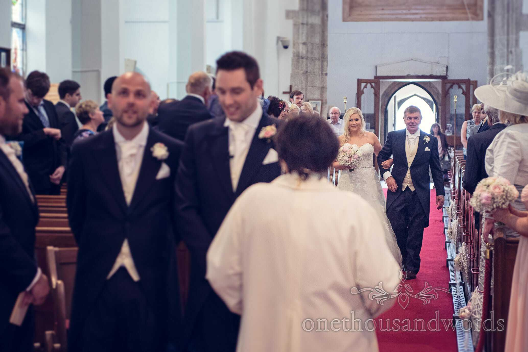 Bride is walked up the aisle by her father in Wareham church wedding