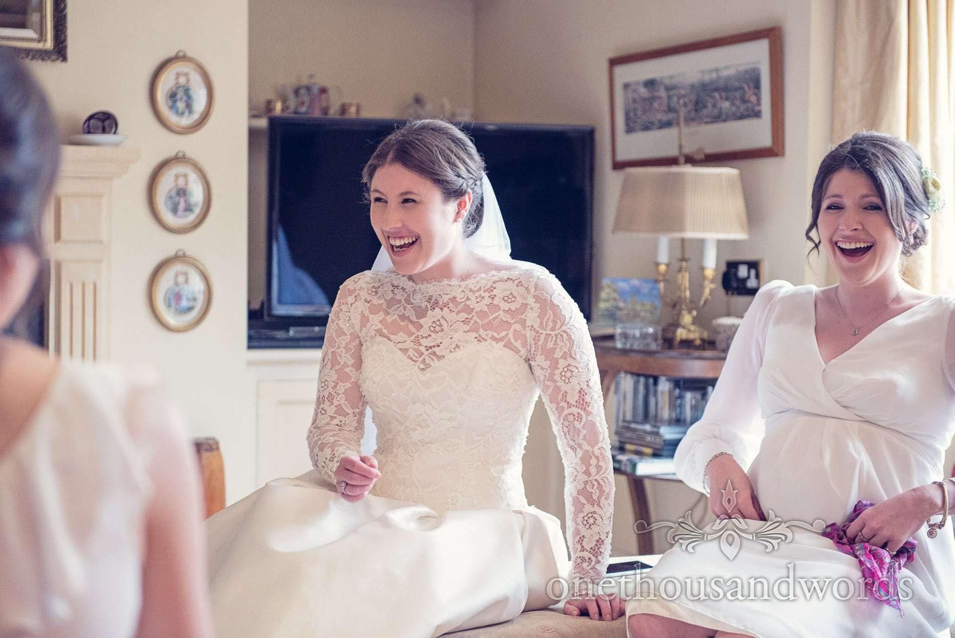 Bride laughs with bridesmaids on wedding morning in Wareham, Dorset
