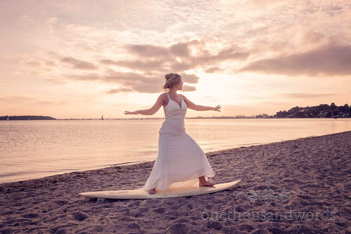 Bride on surfboard at Italian Villa Wedding Photographs