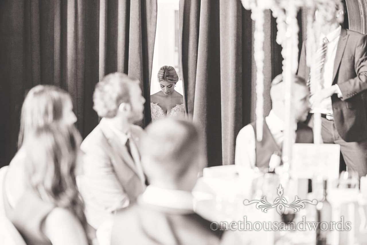 Bride through the curtain at Rhinefield House Wedding