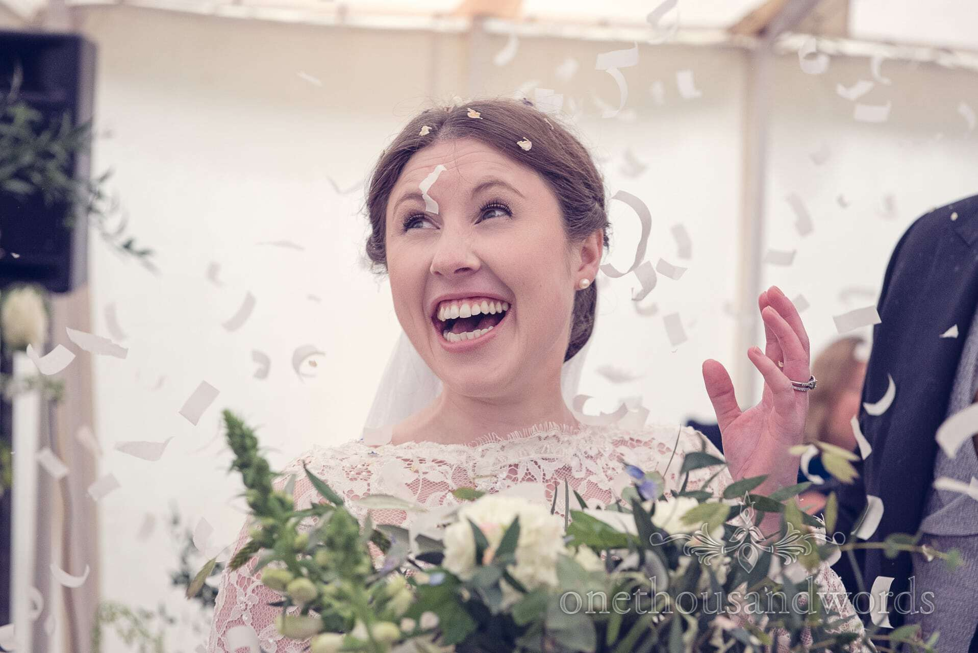 Bride with confetti at her The Priory Wareham wedding