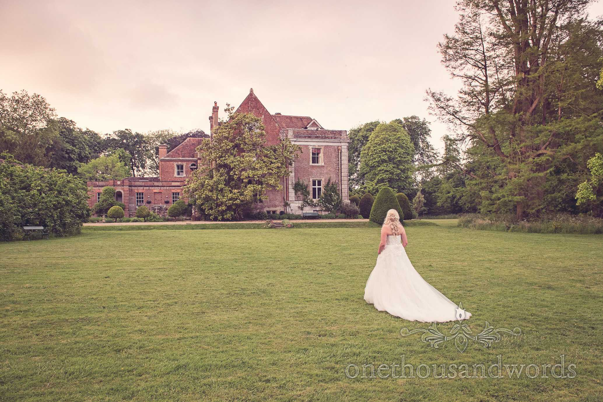 Bride with Deans Court House and Gardens on wedding evening