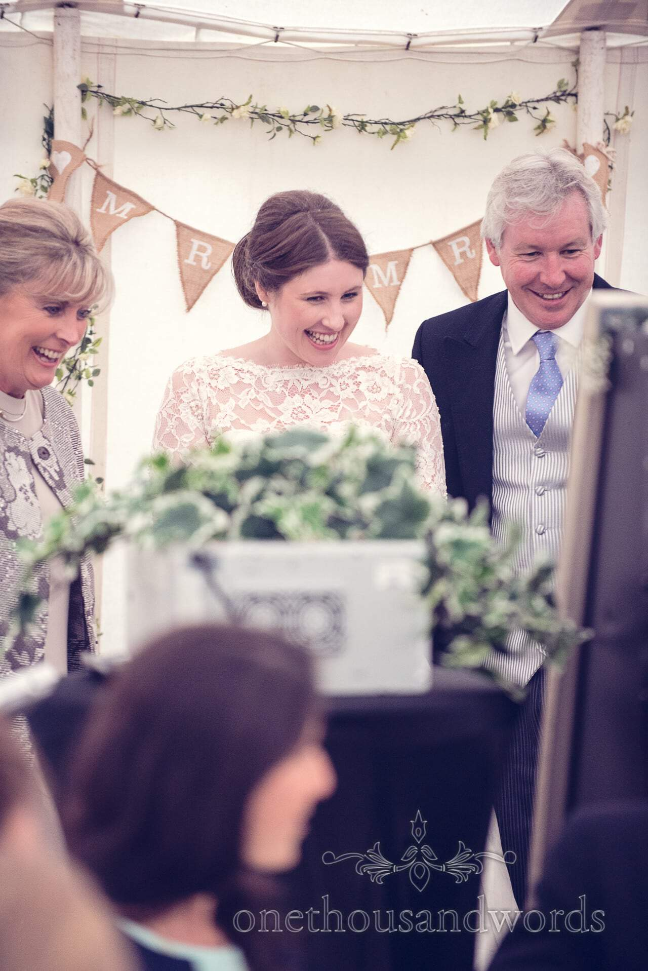 Bride with parents at The Priory Wareham wedding