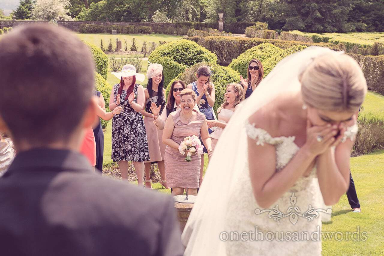 Brides bouquet is caught at Rhinefield House Wedding