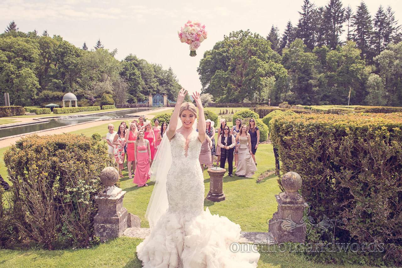 Brides bouquet is thrown at Rhinefield House Wedding