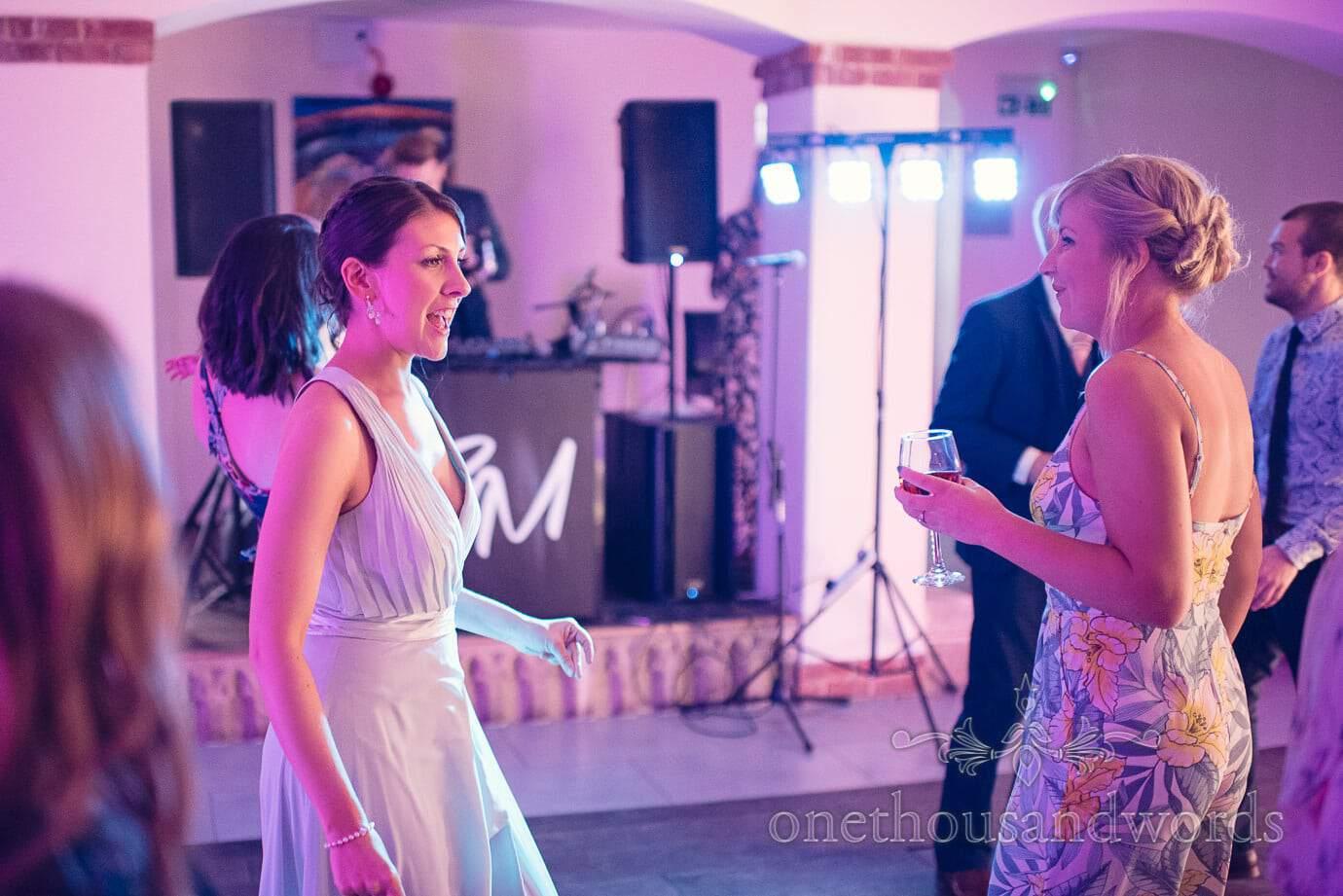Bridesmaid and guest dance at Italian Villa Wedding Photographs