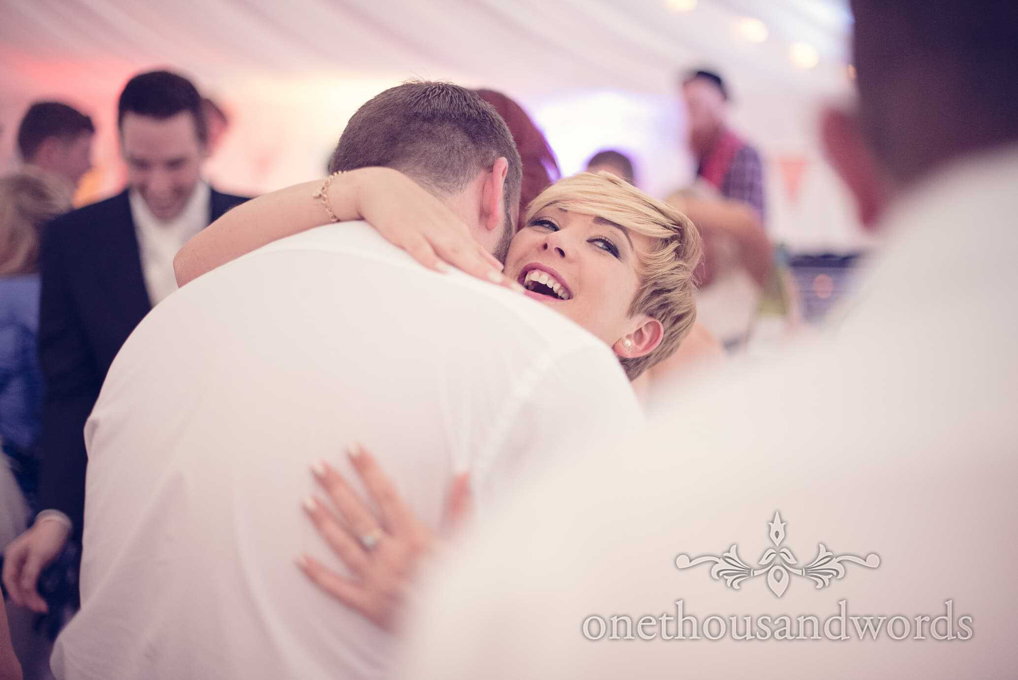 Bridesmaid hugs during dancing at Deans Court Wedding