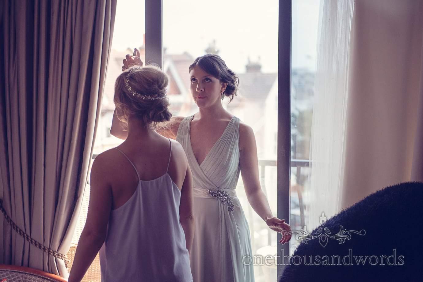 Bridesmaid sprays perfume at Italian Villa wedding photographs