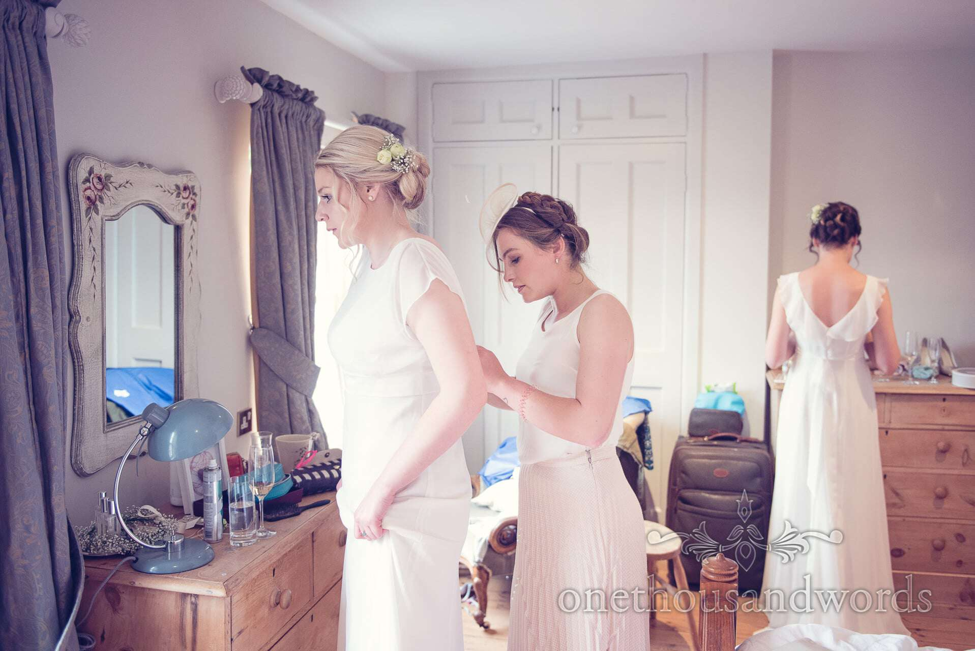 Bridesmaids in white and cream dresses on wedding morning in Wareham