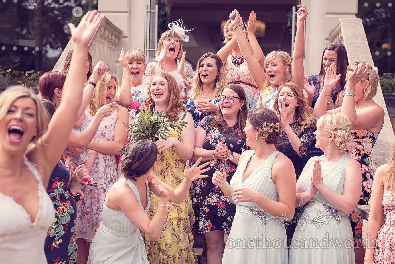 Catching the bouquet at Italian Villa Wedding Photographs