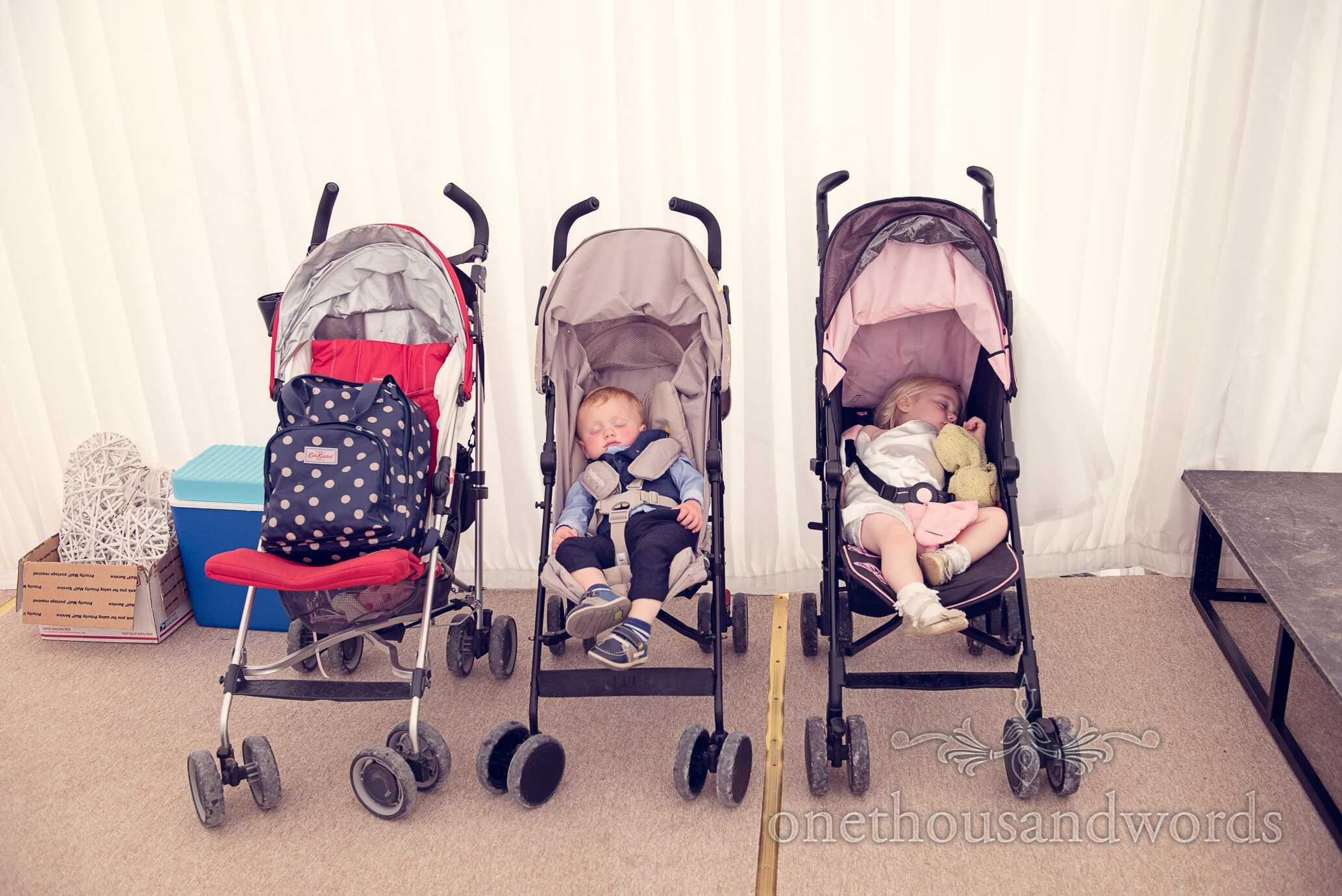 Child wedding guests sleep in prams at Deans Court Wedding