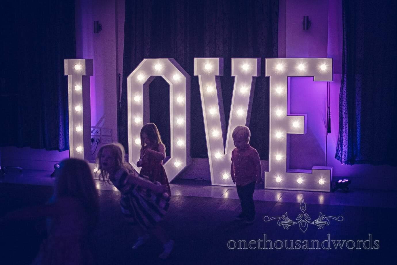 Children and Love signage at Italian Villa Wedding Photographs