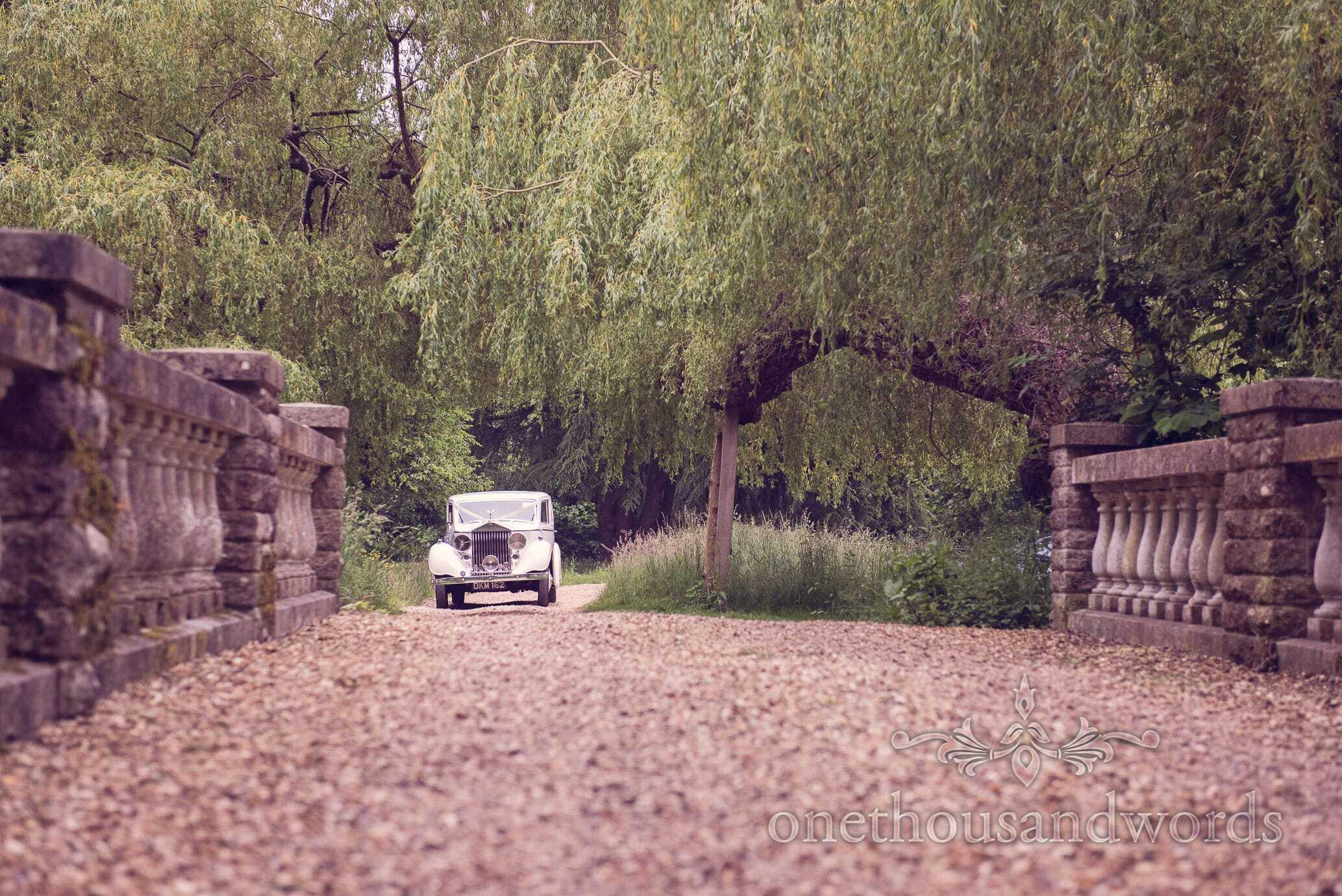 Classic Rolls Royce wedding car arrives at Deans Court Wedding