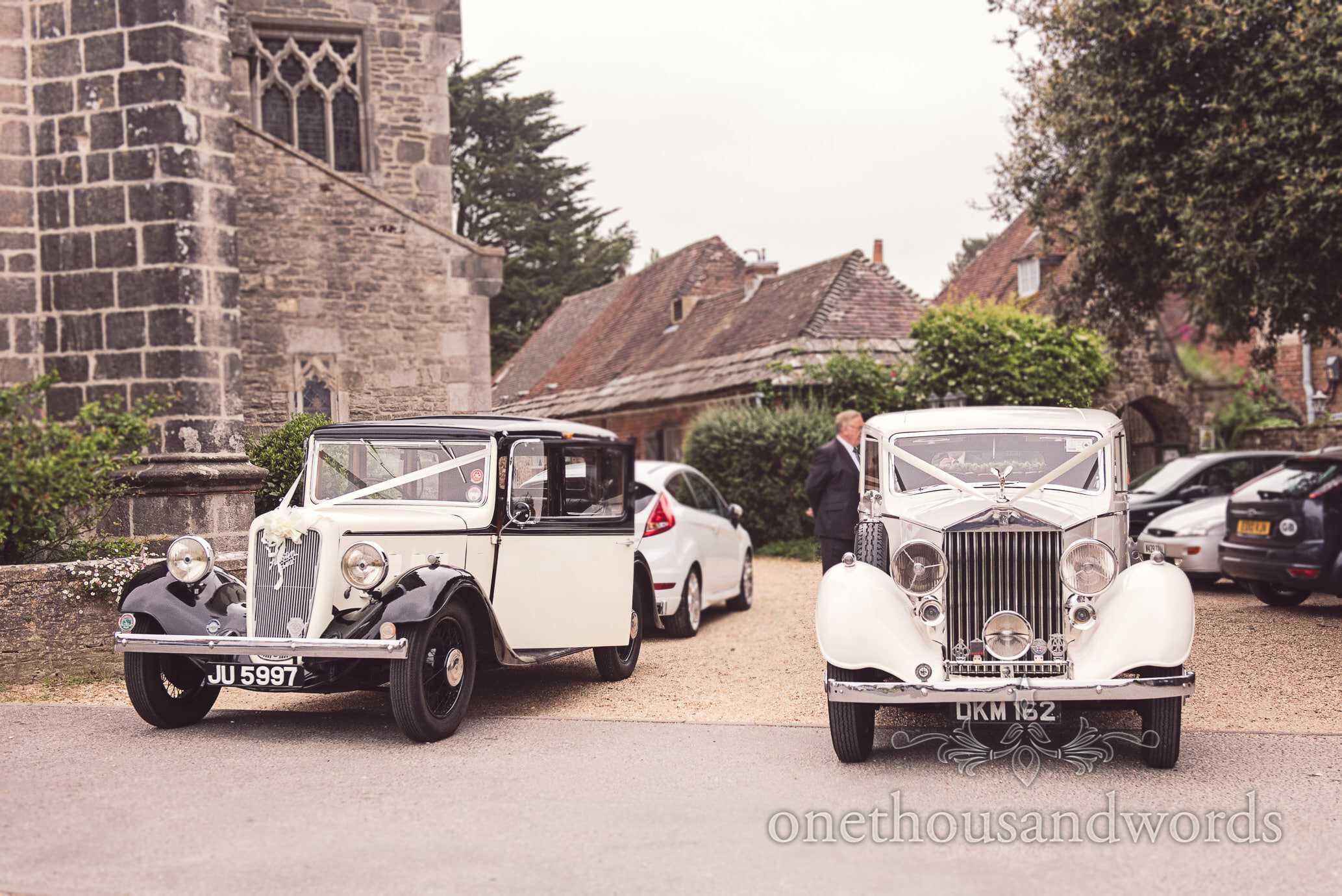 Classic wedding cars outside Wareham church wedding in Dorset