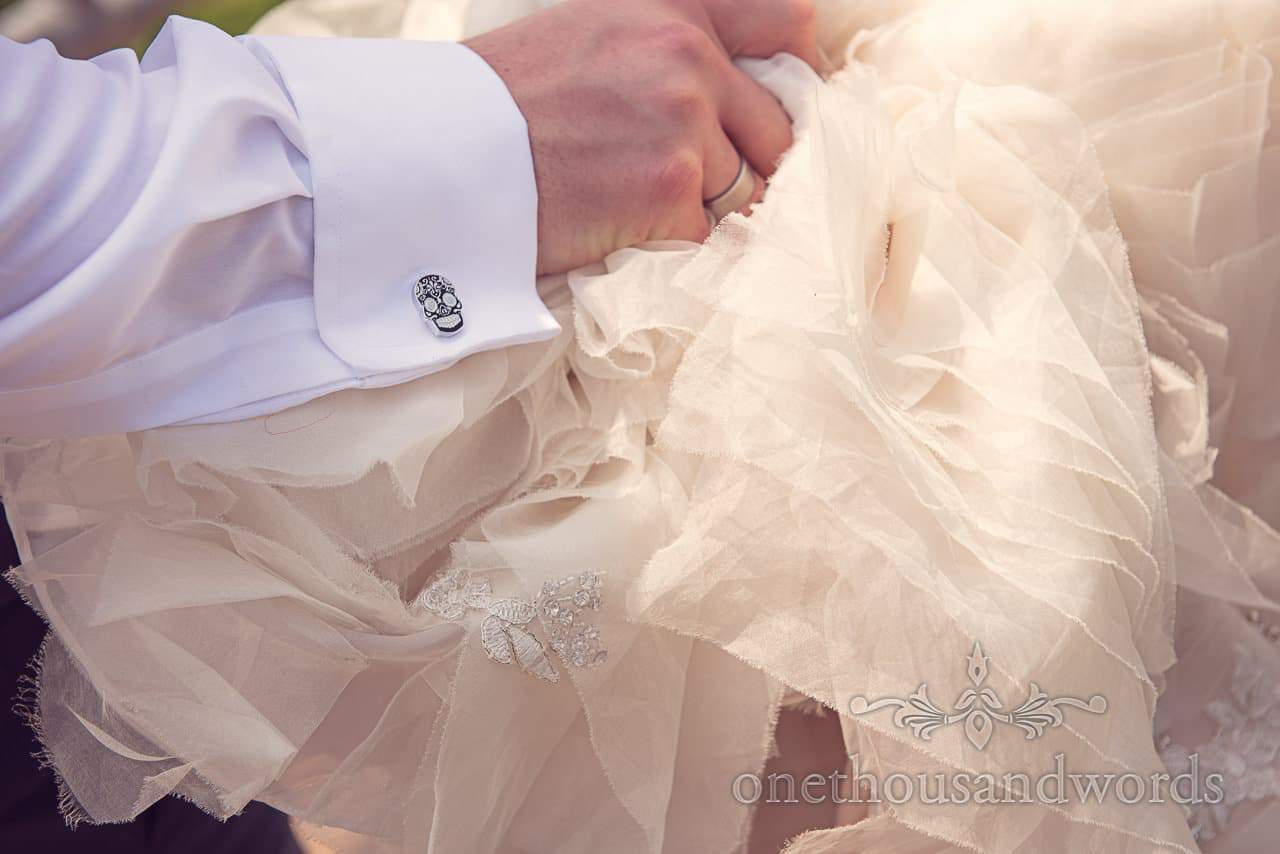 Cuff link and dress detail at Rhinefield House Wedding