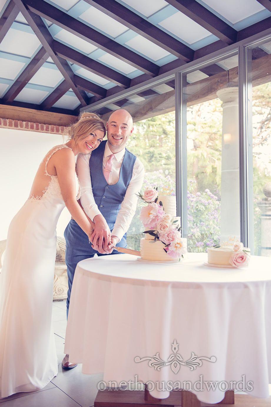 Cutting the cake at Italian Villa Wedding Photographs
