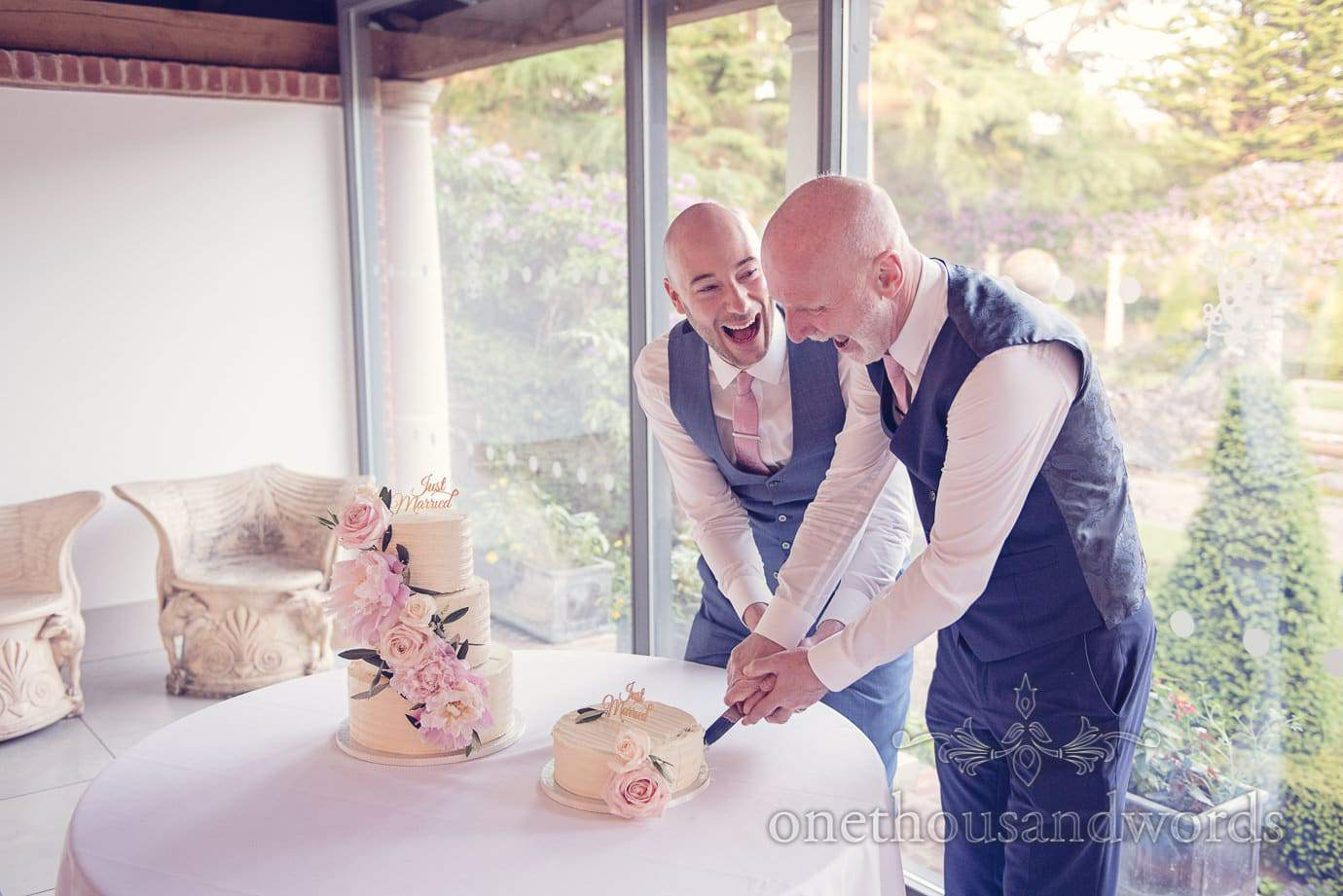 Cutting the second cake at Italian Villa Wedding Photographs