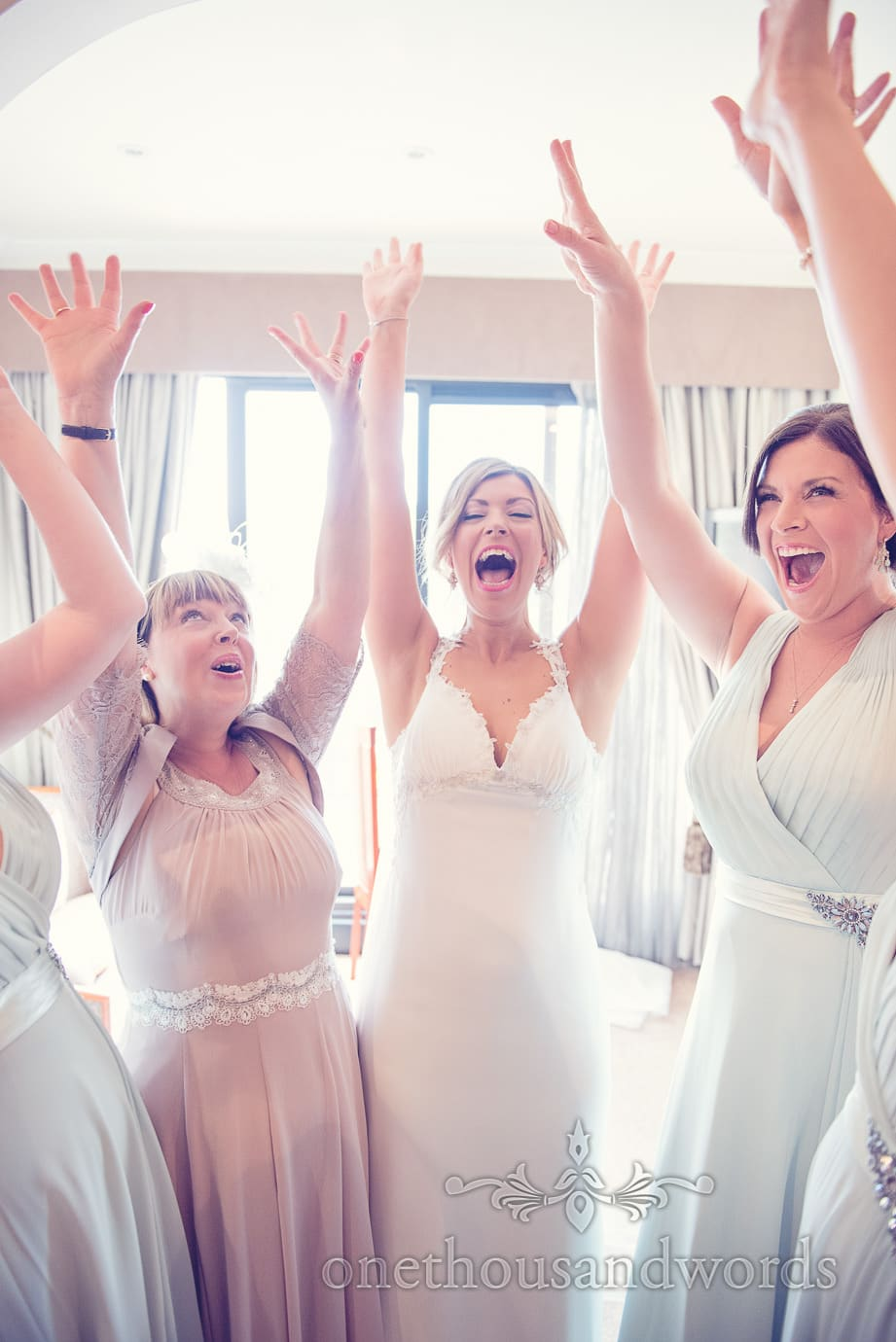 Excited bride, mother and bridesmaids at Italian Villa Wedding Photographs