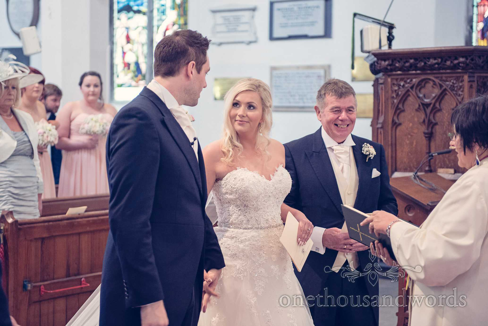Father of bride, bride and groom at church wedding ceremony in Dorset